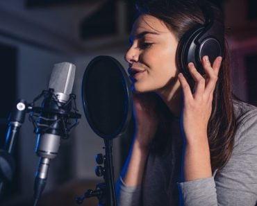 Close up of female vocal artist singing in a recording studio(Jacob Lund)s