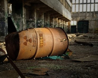 Radioactive warning on old rusty barrel in destroyed and forgotten building(Skorzewiak)s
