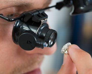 Close-up Of Jeweler Looking Ring Through Magnifying Loupe(Andrey_Popov)S