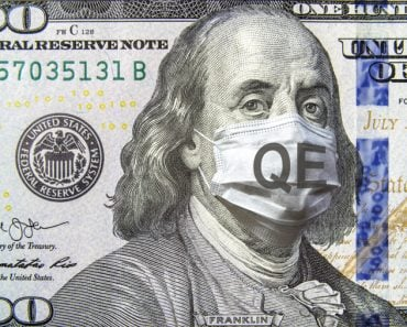 COVID-19 coronavirus in USA, 100 dollar money bill with face mask