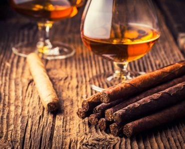 quality cigars and cognac on an old wooden table(Adrian_am13)s