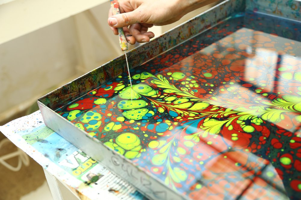 Ebru is a Turkish traditional painting method to transfer paint from a special fluid onto paper(Zinemo)s