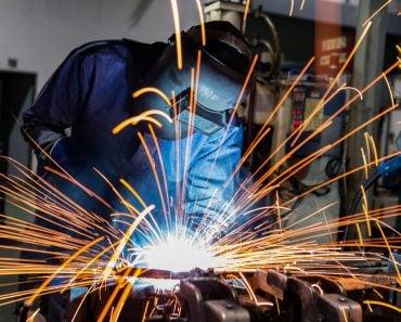 welder is welding metal part in car factory(Factory_Easy)s