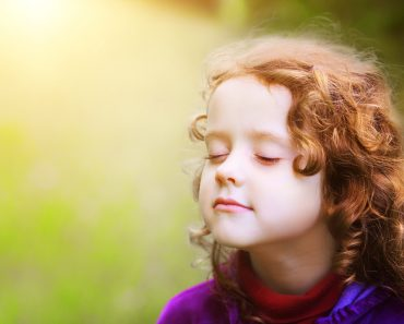Little girl closed her eyes and breathes the fresh air in the park(Yuliya Evstratenko)S
