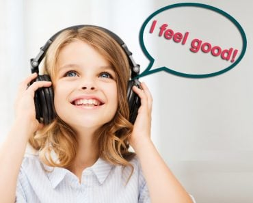 i feel good image, home, technology and music concept - little girl with headphones at home