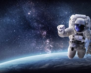 Astronaut in outer space over the planet Earth(Dima Zel)s