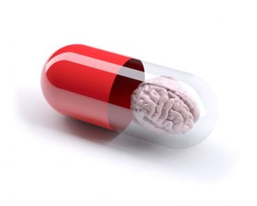 red pill filled with brain, isolated 3d illustration(Fabio Berti)s