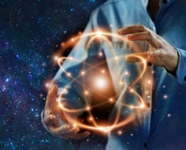 Abstract science, hands holding atomic particle, nuclear energy imagery and network connection on meteorites space planets background(PopTika)s