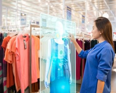 happy girl try to use smart hologram display with virtual augmented reality in the shop(Fit Ztudio)S
