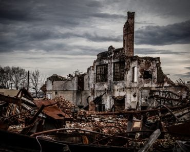 Wide angle shot of a dramatic and gloomy photo of a collapsing vintage brick industrial building left abandoned(R. Wellen Photography)s