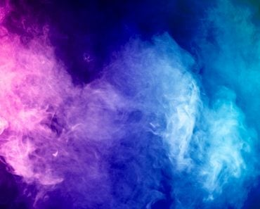 Blue, pink, purple vape smoke on black isolated background(Everyonephoto Studio)s