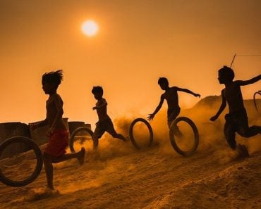 children playing with tire