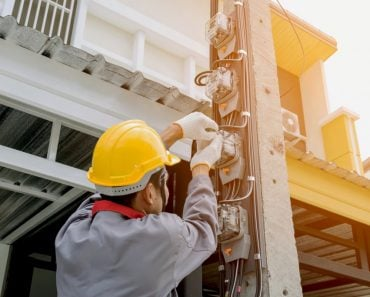 electricians-wear-safety-helmets-jackets-and-protective-gloves-using-a-screwdriver-install-a-meter-to_t20_QzOV1k