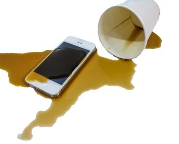 Modern,Smartphone,With,Hot,Coffee,Cup,Wet,,accident.