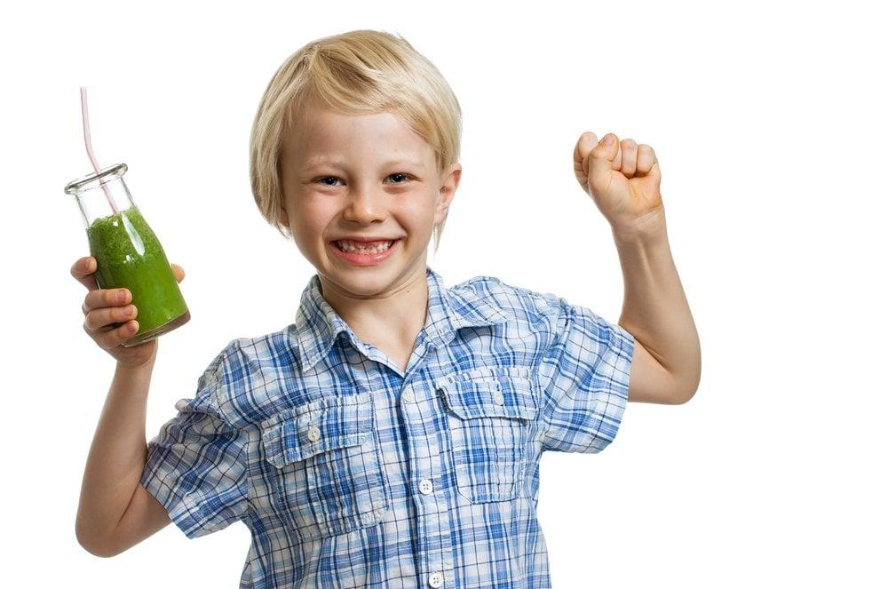 Boy drinking Spinach Juice