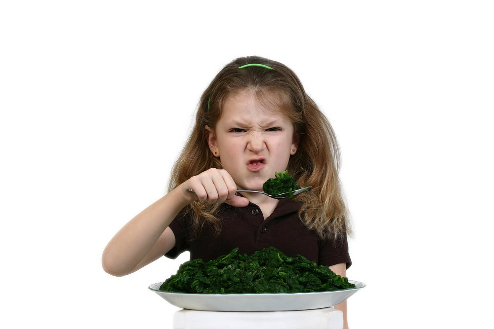 Girl Eating Spinach