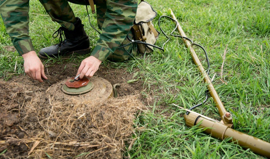 Land Mine Detected and Uncovered (Photo Credit: kanzefar / fotolia)