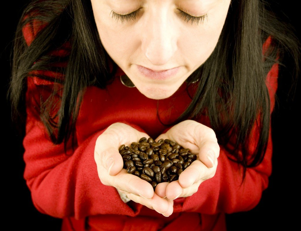girl smelling coffee beans