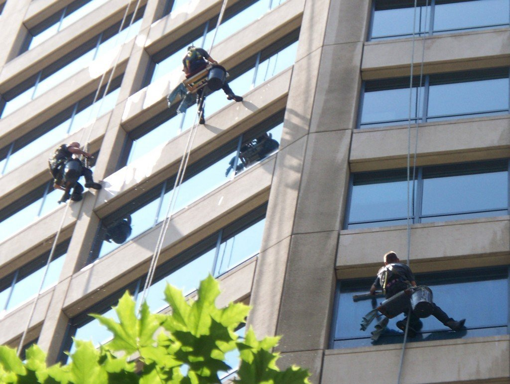 window washing high rise building