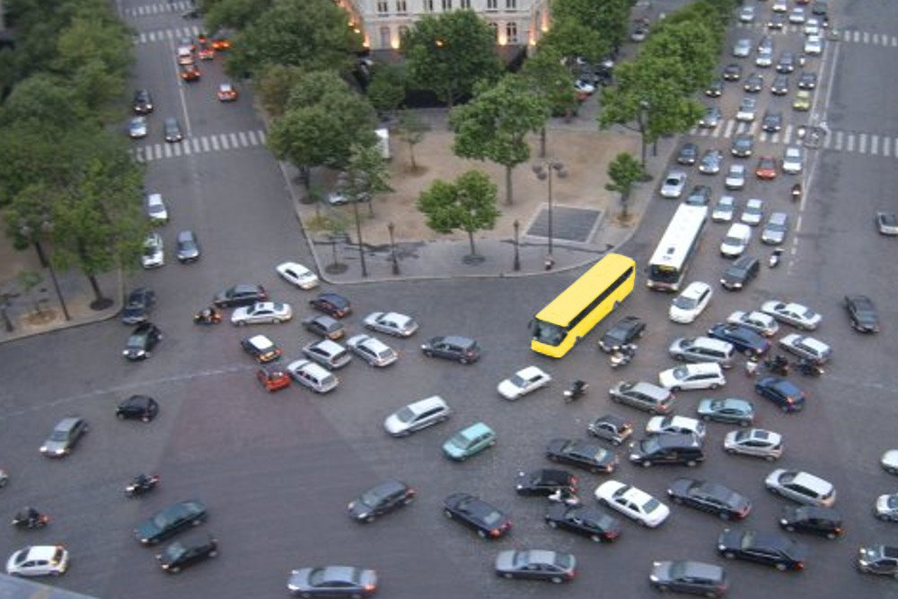 Yellow bus in traffic