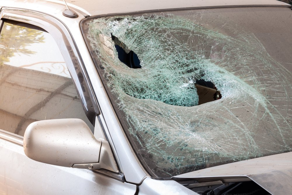 Crashed car with broken windshield glass , transportation accident