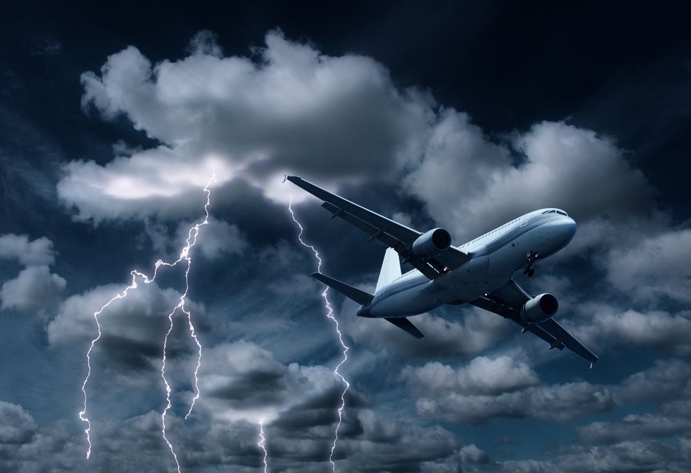 aeroplane yielding turbulent thunderstorm and lightnings