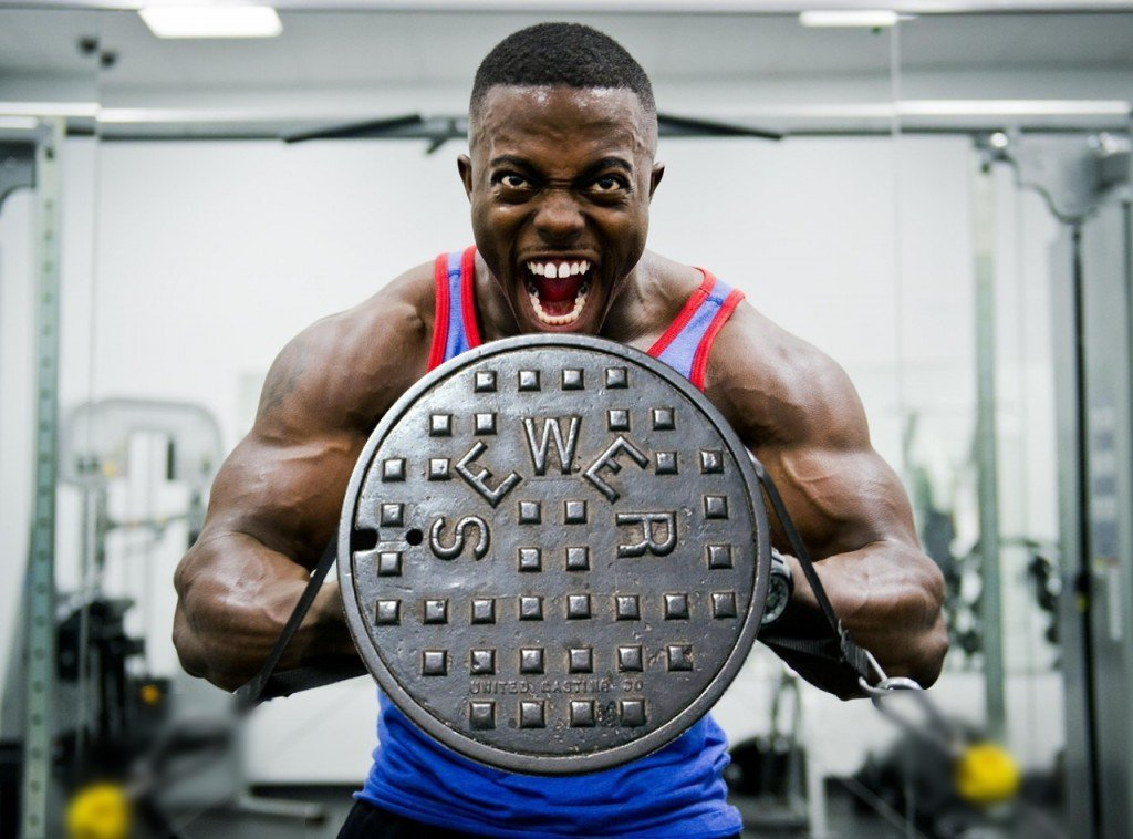 Bodybuilder lifting manhole cover in Stress Meme funny