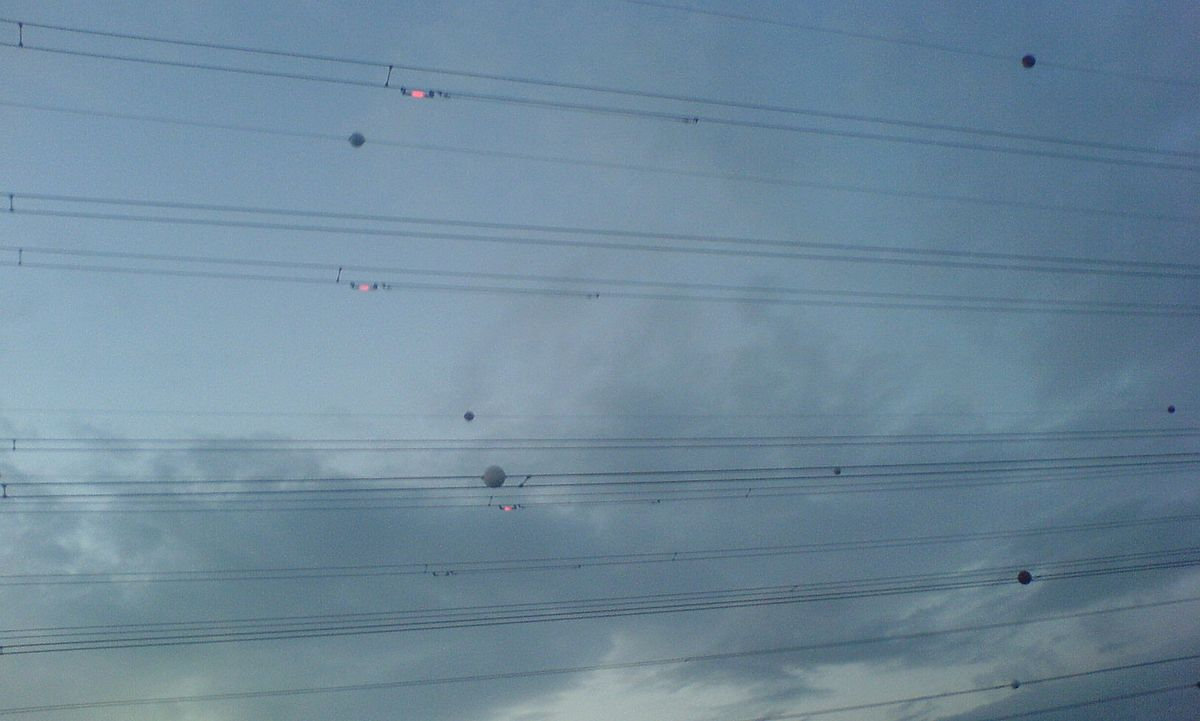 Photograph showing Balisor beacons in use on high voltage cables