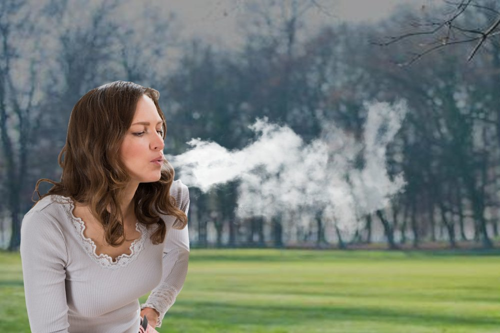 Young Woman blowing breath cloud