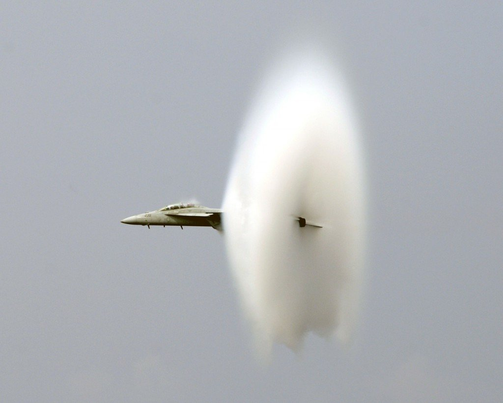 Fighter jet breaking the sound barrier & making sonic boom