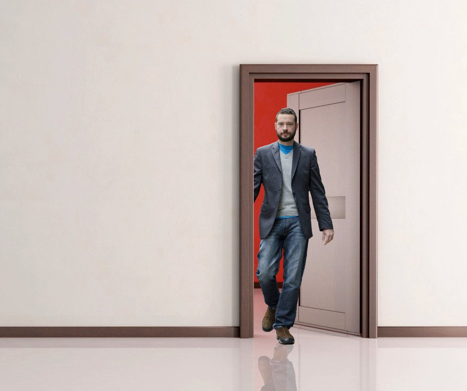 Man walking through the doorway