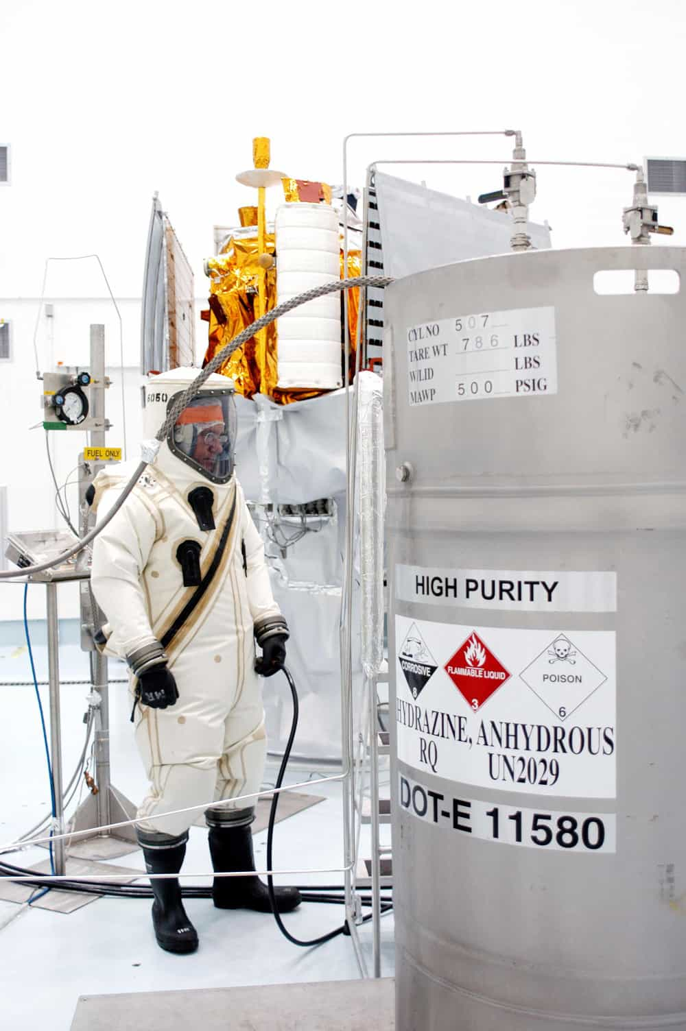 The hypergolic fuel hydrazine being loaded onto the MESSENGER space probe. Note the safety suit the technician is wearing.
