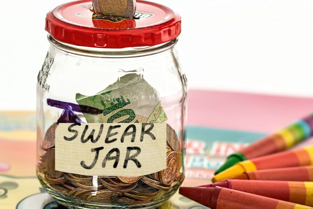 Swear jar penny in jar