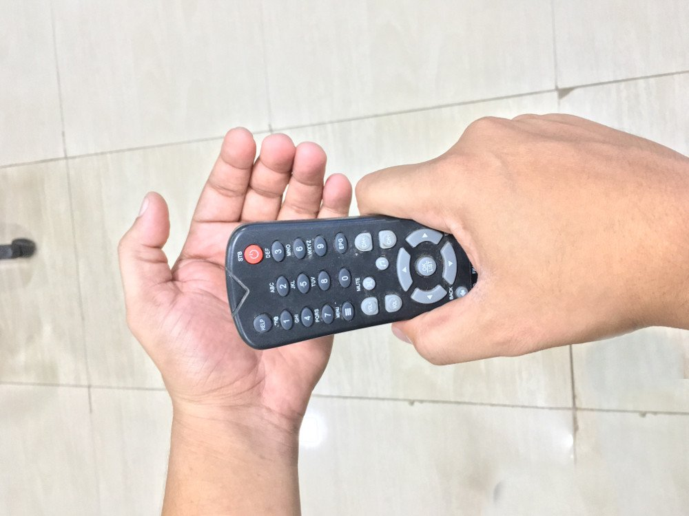 Slapping a (faulty) TV remote sometimes makes it work.