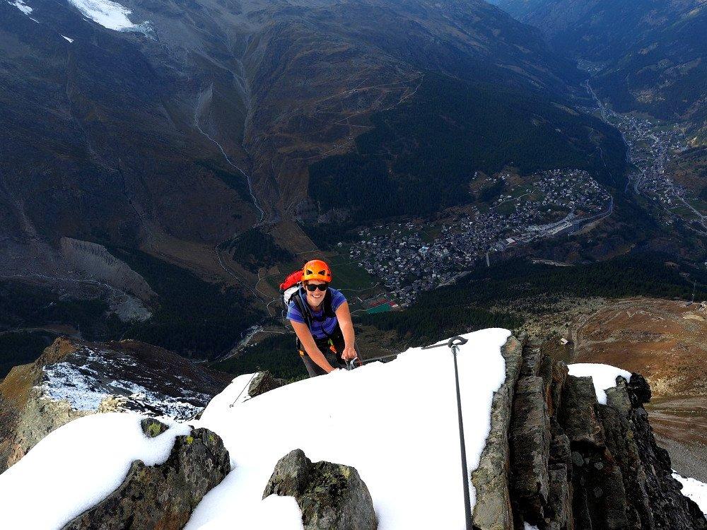 Girl climbing on ice mountain