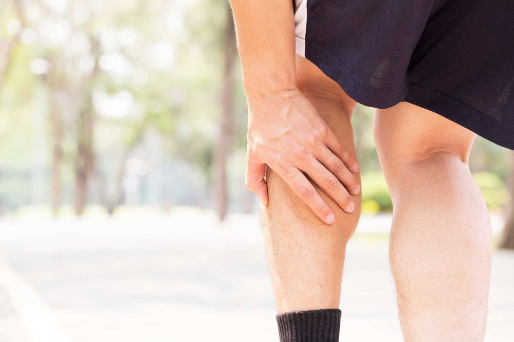 Cramp in leg while exercising. Sports injury concept