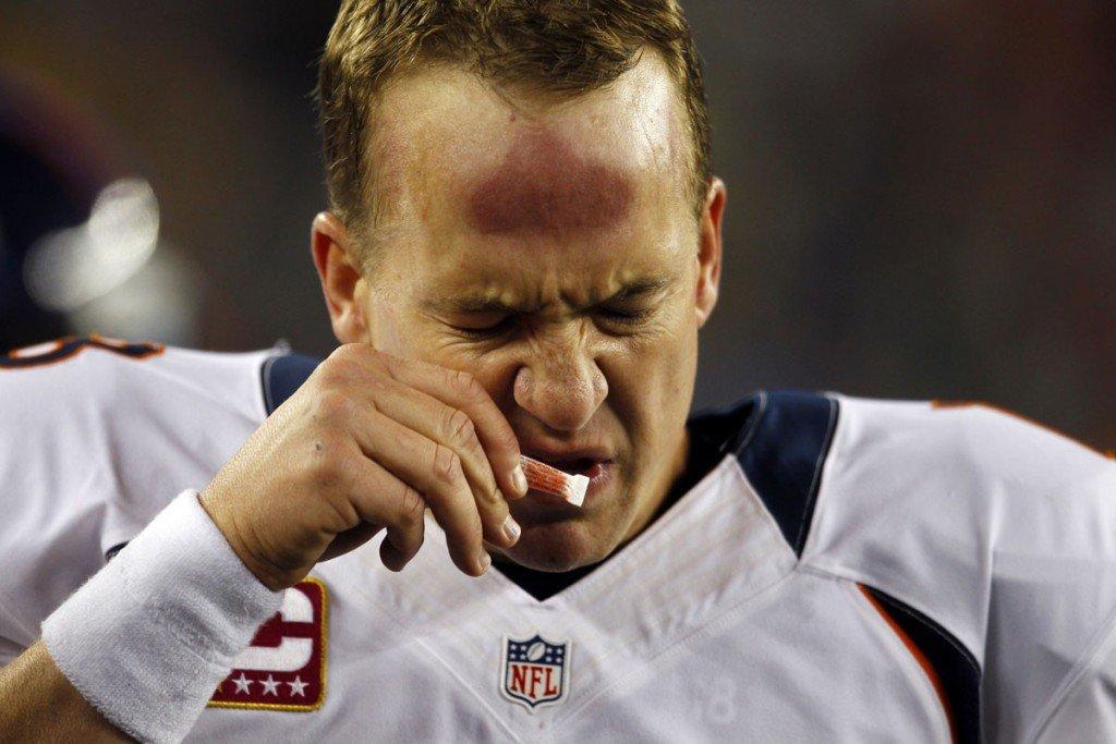 Denver Broncos quarterback Peyton Manning sniffs smelling salts