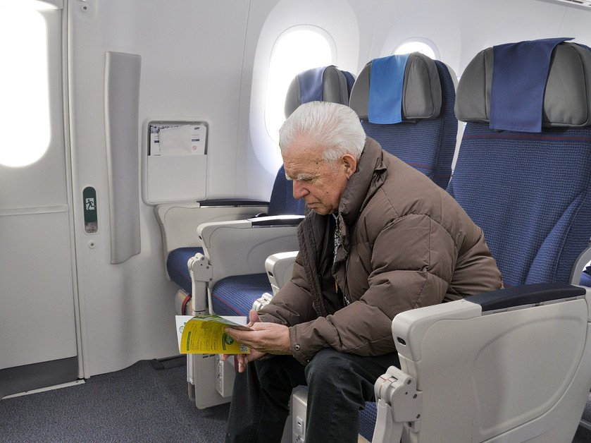 Old man sitting in airplane