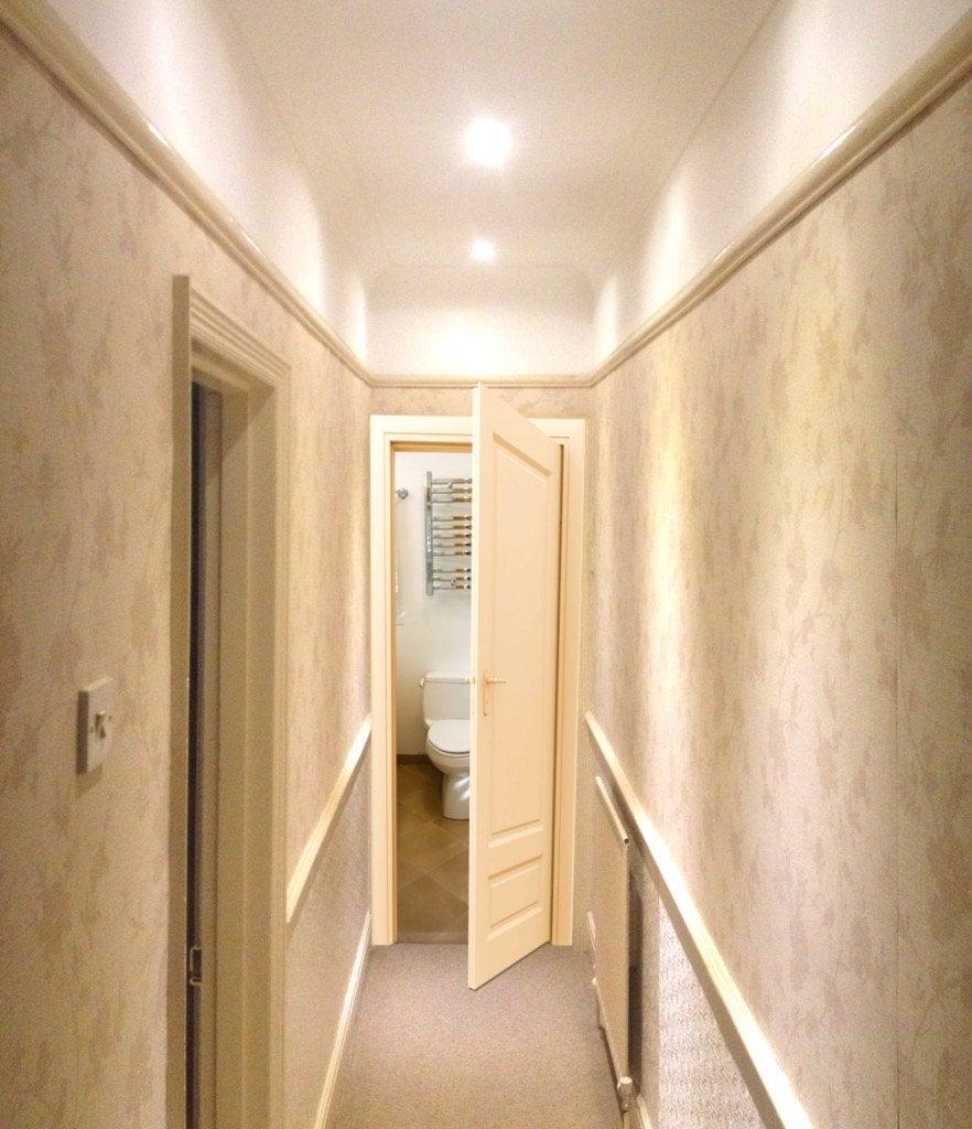Toilet door open in hallway