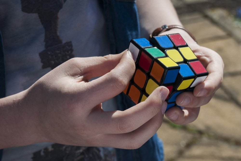 A guy trying to solve Rubik's cube