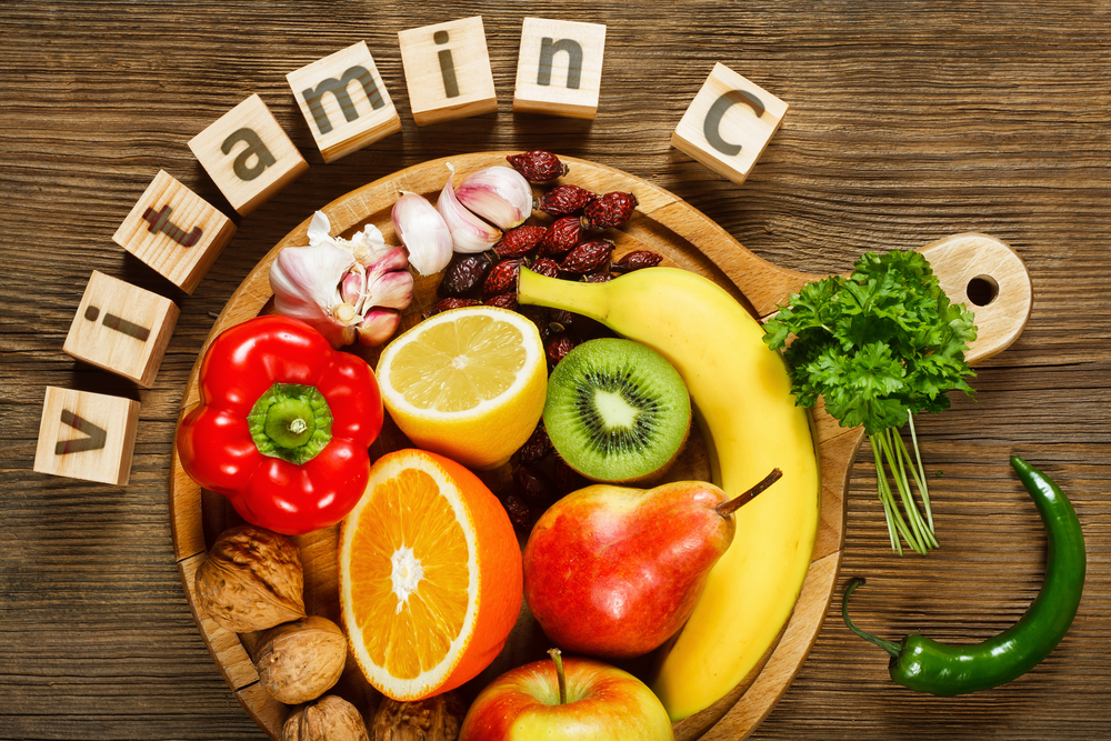 Vitamin C in fruits and vegetables. Natural products rich in vitamin C as oranges, lemons, dried fruits rose, red pepper, kiwi, parsley leaves, garlic, bananas, pears, apples, walnuts, chili. - Image( Evan Lorne)s