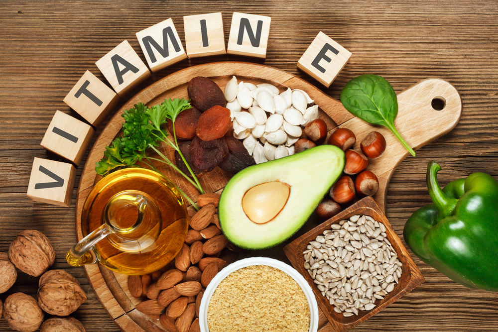 Foods rich in vitamin E such as wheat germ oil, dried wheat germ, dried apricots, hazelnuts, almonds, parsley leaves, avocado, walnuts, pumpkin seeds, sunflower seeds, spinach and green paprika - Image( Evan Lorne)s