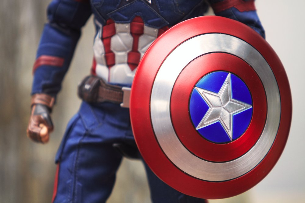 BANGKOK THAILAND - JUNE 17 ,2018 Close up shot of Shield for Captain America Civil War superheros figure in action fighting. Captain america appearing in American comic books by Marvel. - Image(phol_66)s
