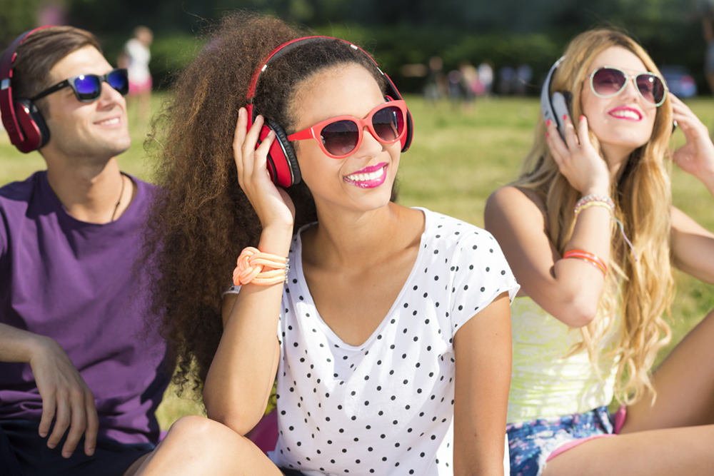 Cropped shot of a group of people wearing headphones and listening to music in the open air - Image(Photographee.eu)s