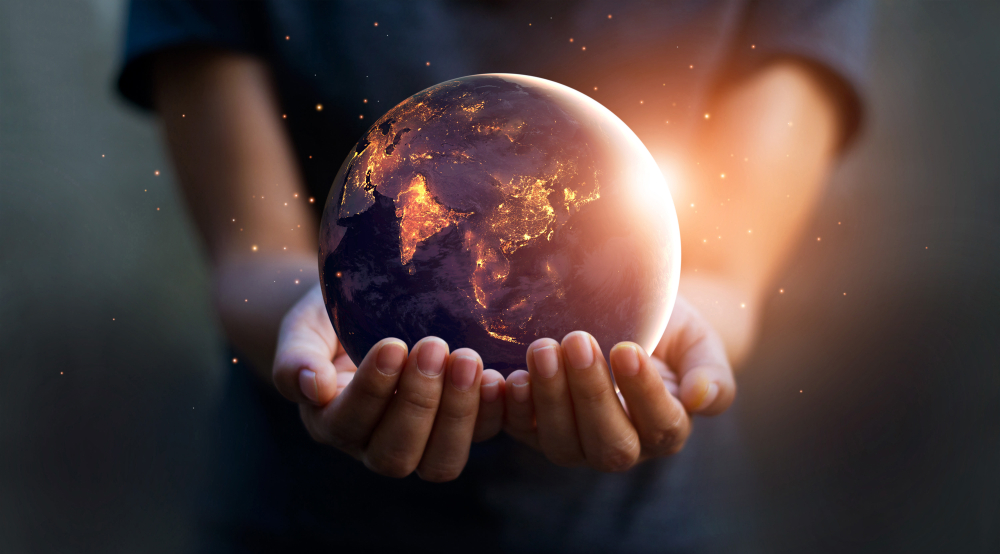 Earth at night was holding in human hands. Earth day. Energy saving concept, Elements of this image furnished by NASA - Image(PopTika)s