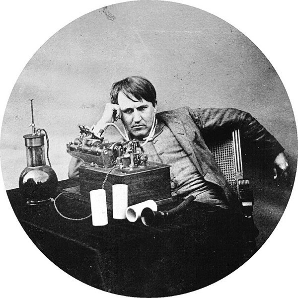 Thomas Edison with a primitive set of headphones