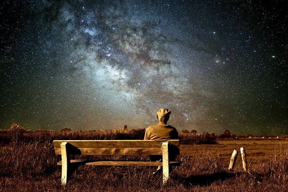 old man sitting alone universe
