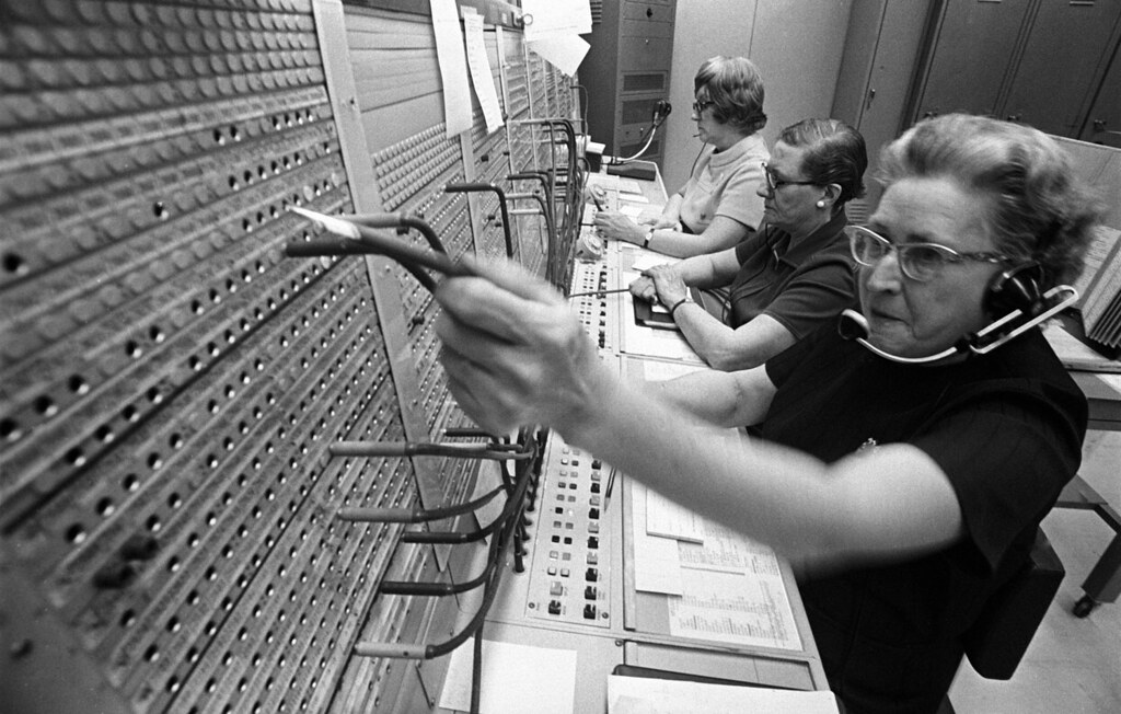 operator using an old fashioned switchboard
