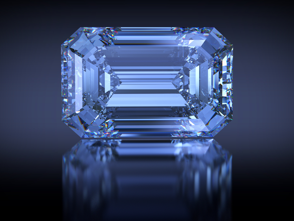 Big rectangle emerald-cut Oppenheimer Blue diamond with reflection on dark blue background(SPbPhoto)S