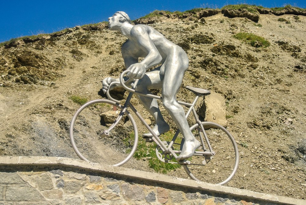 COL DU TOURMALET, FRANCE - AUGUST 21 The large statue of Octave Lapize gasping for air as he struggles to make the climb in the Tourmalet( Ander Dylan)s